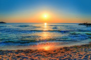 Beautiful background with colorful sunrise over the sea in Costinesti beach, Constanta - Romania