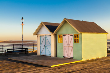 2 beach huts painted in pastel colours on Southend Pier