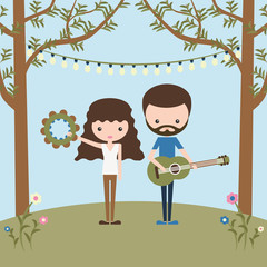 Longhaired girl with tambourine and bearded boy with guitar