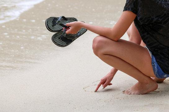 Tourists girls wearing sandals or slipper enjoy the beach