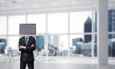 Businessman with laptop instead of head.