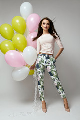 Beautiful Woman With Balloons In Fashion Clothes
