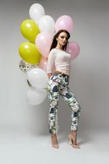 Women Fashion. Beautiful Female With Balloons
