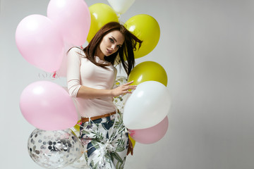 Fashion Woman. Beautiful Female In Fashion Clothes With Balloons