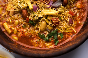 Misal Pav or misalpav, Misal Pav with Farsan. Traditional Indian spicy dish made with moth beans (match) and served with farina and bread