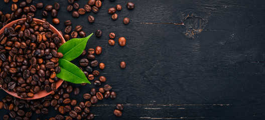 Foto op Plexiglas Cafe Coffee beans. On a wooden background. Top view. Copy space.