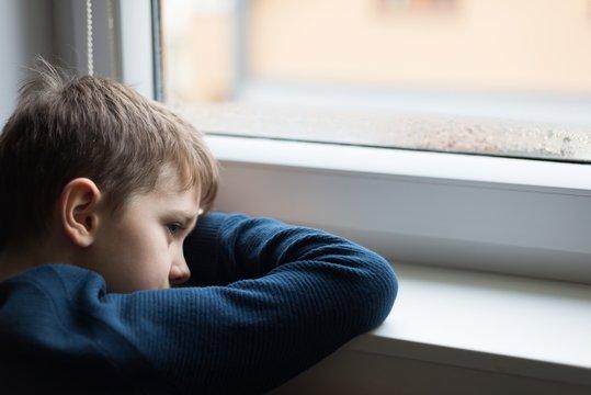 Sad alone little boy child