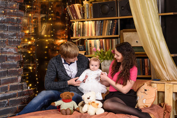 Happy family: beautiful women and handsome men enjoying time with little dauther girl