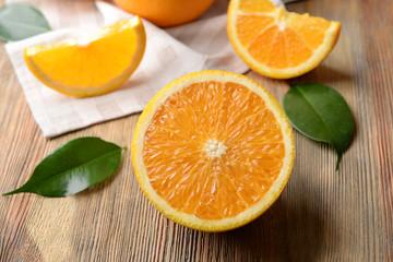 Fresh sliced orange on wooden table
