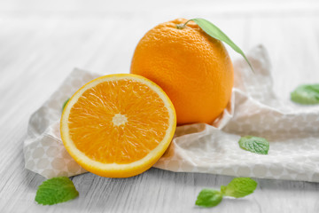 Wall Mural - Fresh oranges on wooden table