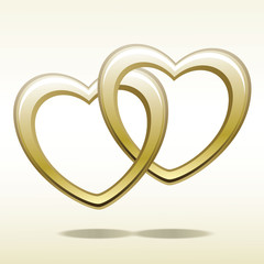 Valentines Day. Gold heart shaped rings attached to each other.