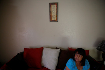 Young watches television in her apartment in the aftermath of tropical storm Harvey in Houston