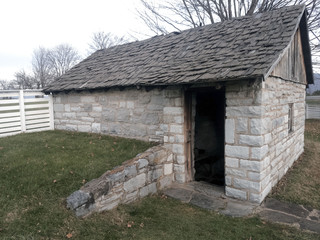 Civil War era stone icehouse with weathered, handmade wooden shake shingle roof
