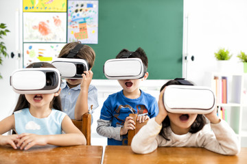 surprised students with virtual reality headset in classroom.