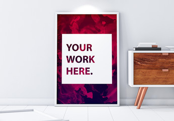 Framed Poster Mockup Leaning Against Wall with Contemporary Furniture
