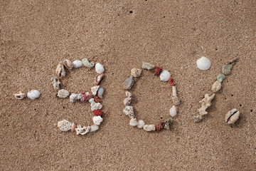 Text 90 percents on sand made from shell on seashore. Concept for big sales or black friday
