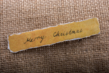 Merry Christmas  written on a torn paper
