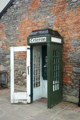 Vintage obsolete telephone booth in rural Ireland