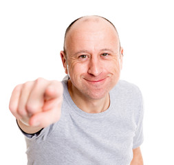 baldheaded man pointing in to the camera and smiling