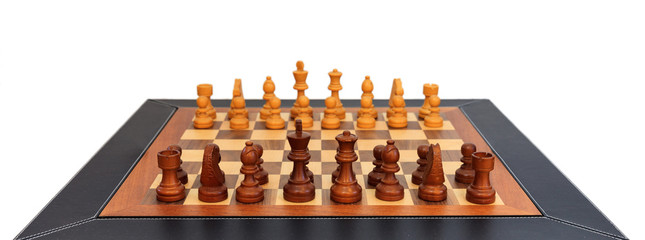 Wooden chess set. Leather frame, close up view, details, white background.