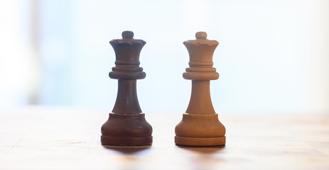 Chess pieces. Close up view of queens with details. Blurred background.