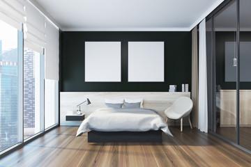 Black bedroom interior, posters