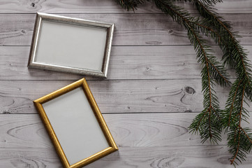 Two frames for photos on a light, vintage wooden background