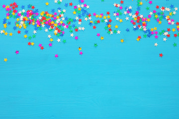 party background with colorful confetti. Top view.