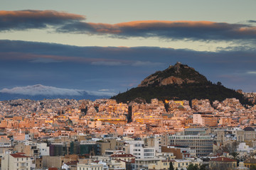 View of Athens and Lycabettus Hill from Areopagus hill at sunset, Greece.