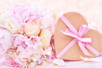 Heart shaped box on wedding pastel flower bouquet, pink valentine decor background, soft romantic festive card, selective focus, shallow DOF, toned
