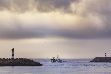 Fishing boat entering harbor after a day fishing