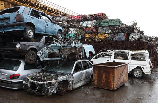 Junk yard with heap of metal waste