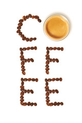 Top view of word coffee made from coffee beans and glass cup of hot coffee, white background