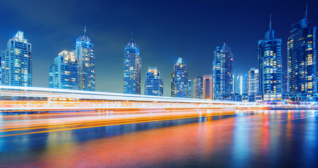 Evening on busy canal and promenade in Dubai Marina,Dubai,United Arab Emirates