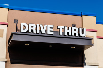 White and Blue Drive Thru sign set against a blue sky II
