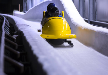 Keuken foto achterwand Wintersporten bob sled speeding in an ice channel