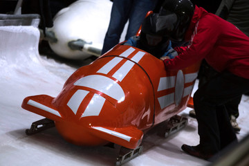 a red bob sled on the start