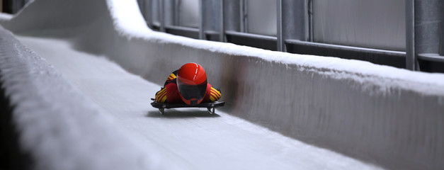 Poster Winter sports skeleton bob sled in ice channel