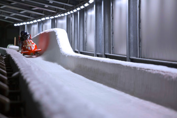 bob sled speeding in an ice channel