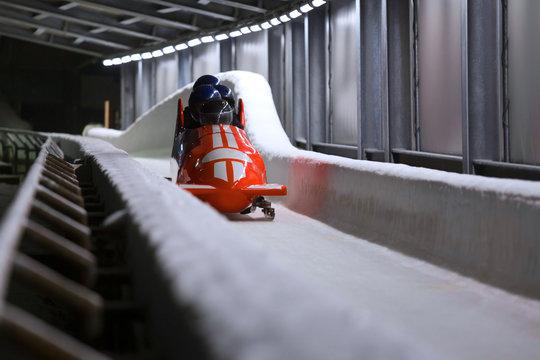 bob sled speeding in an ice channel