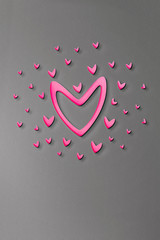 Symbol of love on sweet grey background, greeting card, Flat design. Origami made hot pink heart. Love blue background shapes texture pattern for valentine day concept.