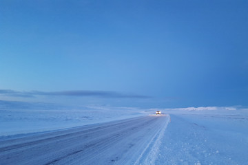 Dawn on a snow covered icelandic road in Thingvellir national park