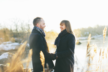 A happy couple beside a river