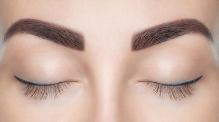 A beautiful woman with unextinguished eyelashes in a beauty salon. Eyelash extension procedure
