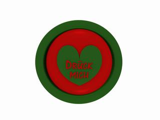 """runder Button in rot-grün mit Herzchen und dem deutschen Text """"drück mich"""""""