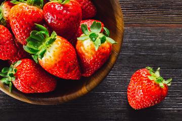 Bowl of Strawberries on Dark Table