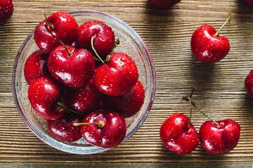 Freshly Washed Cherries on Cedar Table