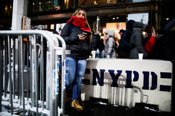 NYPD bollards are seen on a sidewalk in Times Square ahead of New Year's Eve celebrations in Manhattan