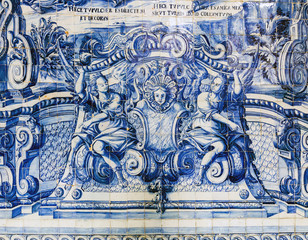 The cloister walls of Porto's Cathedral are decorated with the traditional Portugese blue and white painted tin-glazed ceramic tiles called Azulejos.