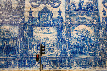 Exterior walls of the Porto's Chapel of Souls in Porto, Portugal are virtually entirely covered with blue and white ceramic tiles, depicting the Martyrdom of Santa Catarina.
